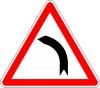 Si je suis en approche d'un virage sur une route en double sens de circulation:
